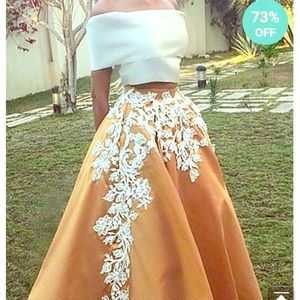 White off the shoulder top &rust embroidery skirt